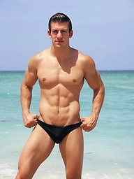 Sexy Zack Johnathan shows off his body on the beach